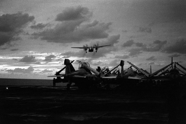 A C-2 Greyhound aircraft carrying the body of LT. Mark Adam Lange takes off from the aircraft carrier USS JOHN F. KENNEDY (CV-67). LT. Lange was killed when his A-6 aircraft was shot down during a bombing raid over Lebanon