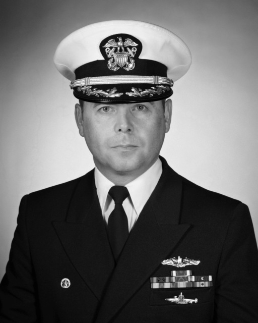 Commander Darrell R. Powell, USN (covered)