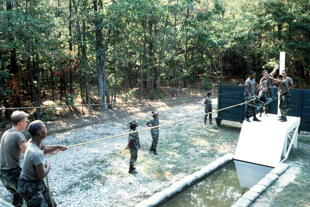 Members of Company G, 2nd Battalion, Quartermaster Battalion, train on one of the various obstacles during the Leadership Readiness Course at the Quartermaster School