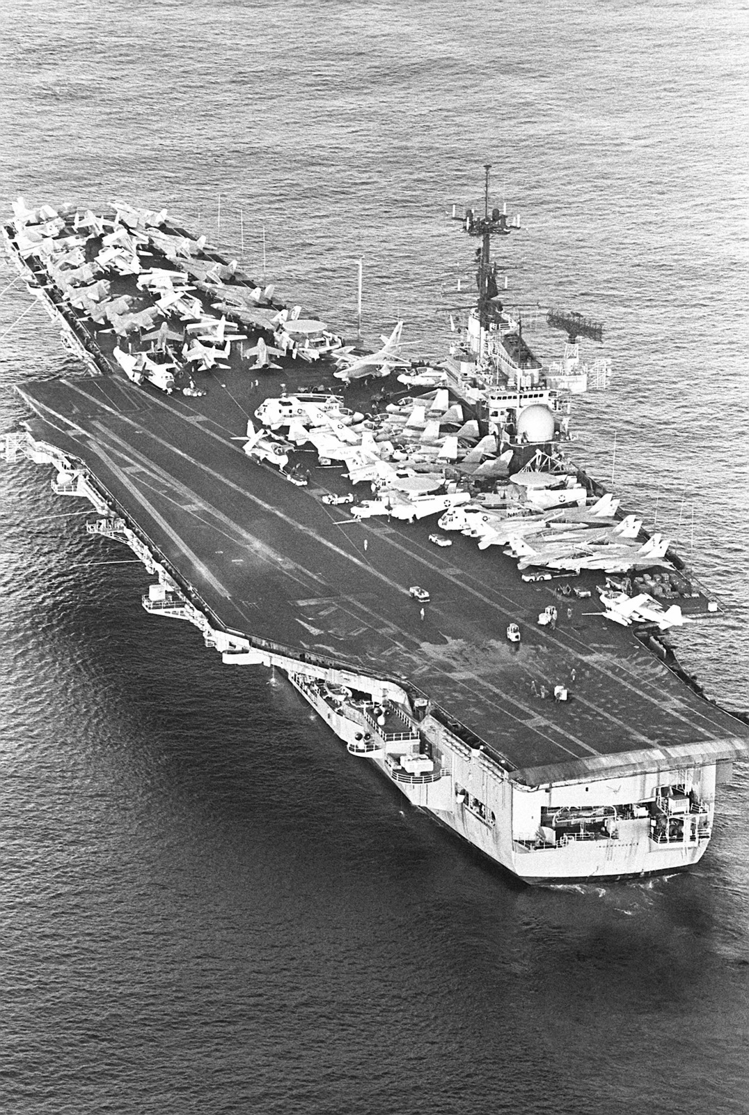 An aerial port quarter view of the aircraft carrier USS INDEPENDENCE (CV 62) underway. The INDEPENDENCE is operating off the coast of Lebanon in support of the US Marines that have been assigned to Beirut as part of a multinational peacekeeping force