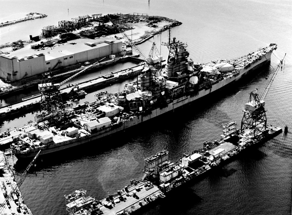 Elevated starboard quarter view of the battleship IOWA (BB 61), undergoing repair and renovation prior to being recommissioned