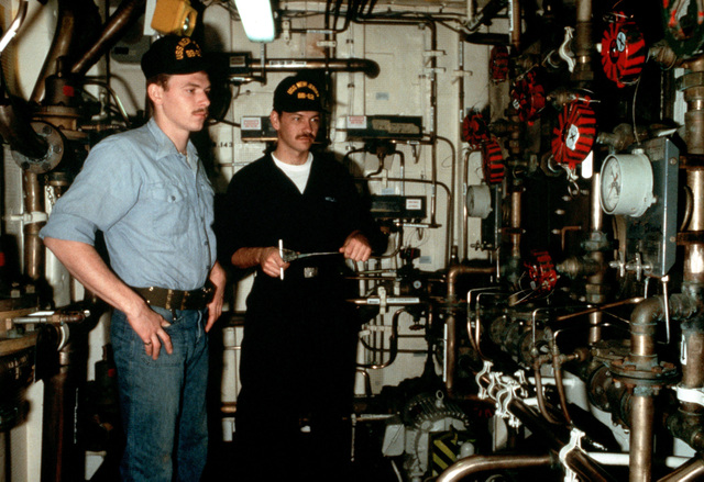 Fireman (FN) Jack Kilgore, left and reserve Hull Technician Fireman (HTFN) Christopher Kellar check meters in one of the firefighing stations of the battleship USS NEW JERSEY (BB 62) during security rounds. HTFN Kellar is serving aboard the NEW JERSEY for a period of active duty training (ACDUTRA)