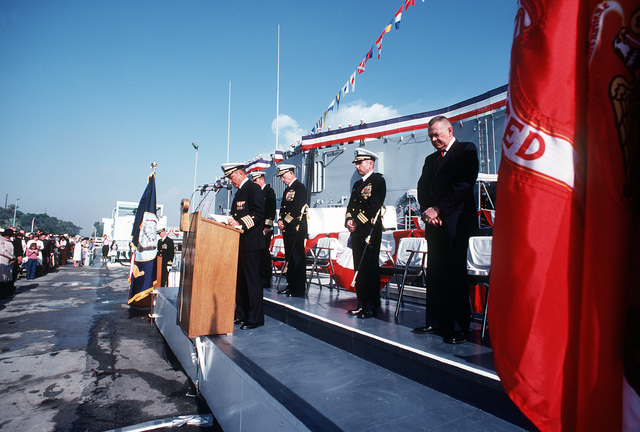CAPT. R.J. Ecker, Chaplain Corps, delivers the benediction at the commissioning ceremony for the guided missile frigate USS MCCLUSKY (FFG-41). Standing behind him are, left to right: CAPT. J.D. Chamberlain, Vice Adm. L. Baggett, CMDR. R.B. Lynch and L. M. Thorell