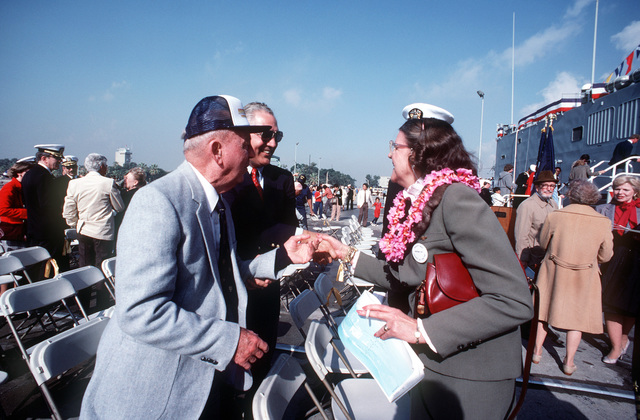 Mrs. Clarence Wade McClusky, right, talks with other guests attending the commissioning ceremony for the guided missile frigate USS MCCLUSKY (FFG 41). Mrs. McClusky is the widow of the ship's namesake, Rear Admiral Clarence W. McClusky