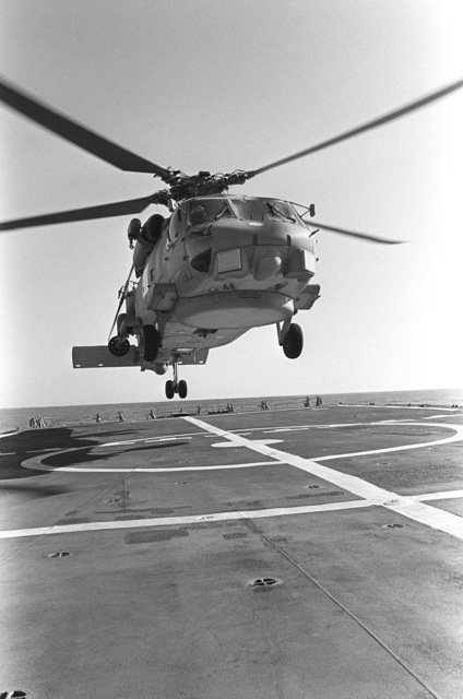 The Navy's first operational Mark III LAMPS (Light Airborne Multi-Purpose System) SH-60B Seahawk helicopter to a landing on the flight deck of the guided missile frigate USS CROMMELIN (FFG 37), during flight deck landing qualifications off the coast of San Clemente, California