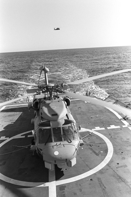 The Navy's first operational Mark III LAMPS (Light Airborne Multi-Purpose System) SH-60B Seahawk helicopter rests on the flight deck of the guided missile frigate USS CROMMELIN (FFG 37). The helicopter is undergoing flight deck landing qualifications off the coast of San Clemente, California