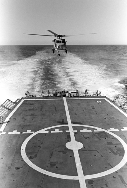 The Navy's first operational Mark III LAMPS (Light Airborne Multi-Purpose System) SH-60B Seahawk helicopter approaches the flight deck of the guided missile frigate USS CROMMELIN (FFG 37), during flight deck landing qualifications off the coast of San Clemente, California