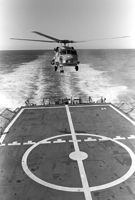 The Navy's first operational Mark III LAMPS (Light Airborne Multi-Purpose System) SH-60B Seahawk helicopter lands on the flight deck of the guided missile frigate USS CROMMELIN (FFG 37), during flight deck landing qualifications off the coast of San Clemente, California