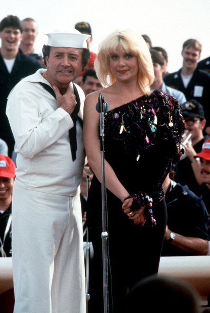 Entertainers Vic Damone and Ann Jillian perform for crewmen aboard the battleship USS NEW JERSEY (BB 62) during the Bob Hope USO Christmas show. The NEW JERSEY is operating off the coast of Beirut, Lebanon