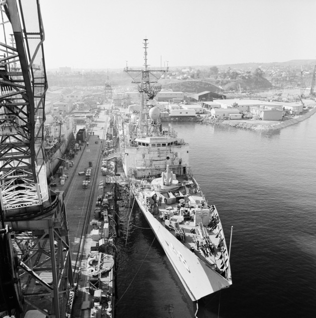 An elevated starboard bow view of the Oliver Hazard Perry-class guided missile frigate USS RENTZ (FFG 46) under construction at Todd Pacific Shipyards. The ship is 80 percent complete