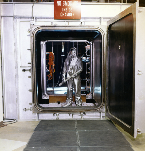 Photograph of a NASA Technician Emerging from a New Space Environment Simulator