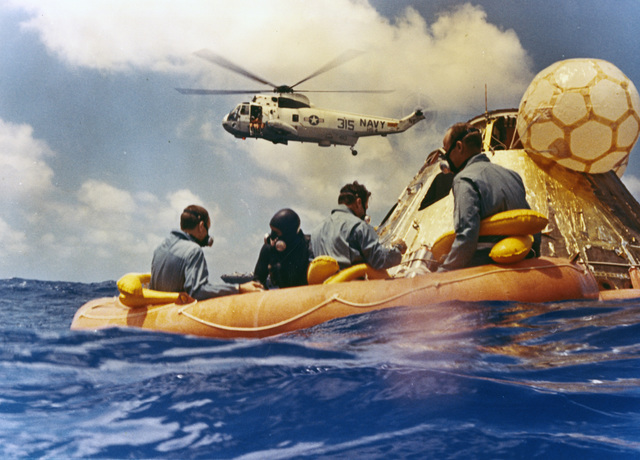 Photograph of Apollo 12 Astronauts Awaiting Pickup by Rescue Helicopter