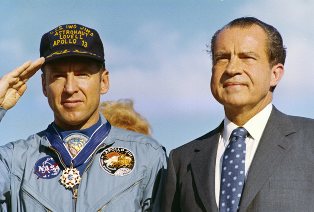 Photograph of Apollo 13 Flight Commander James A. Lovell, Jr. Standing alongside President Richard M. Nixon