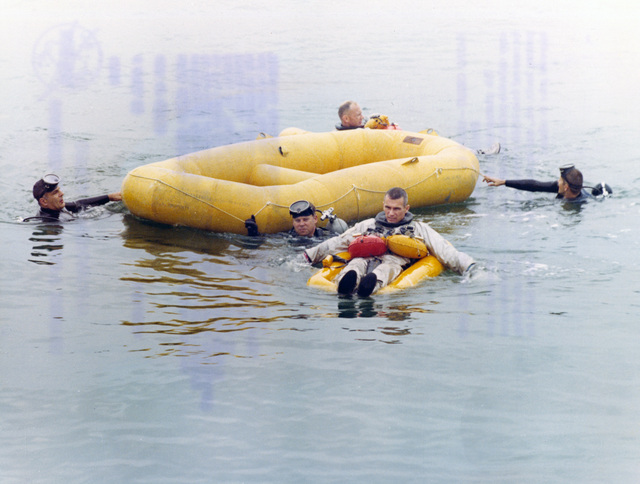 Photograph of Gemini IX Prime Crew Pilot Eugene A. Cernan and Backup Crew Pilot Edwin E. Aldrin Jr. during Water Egress Training