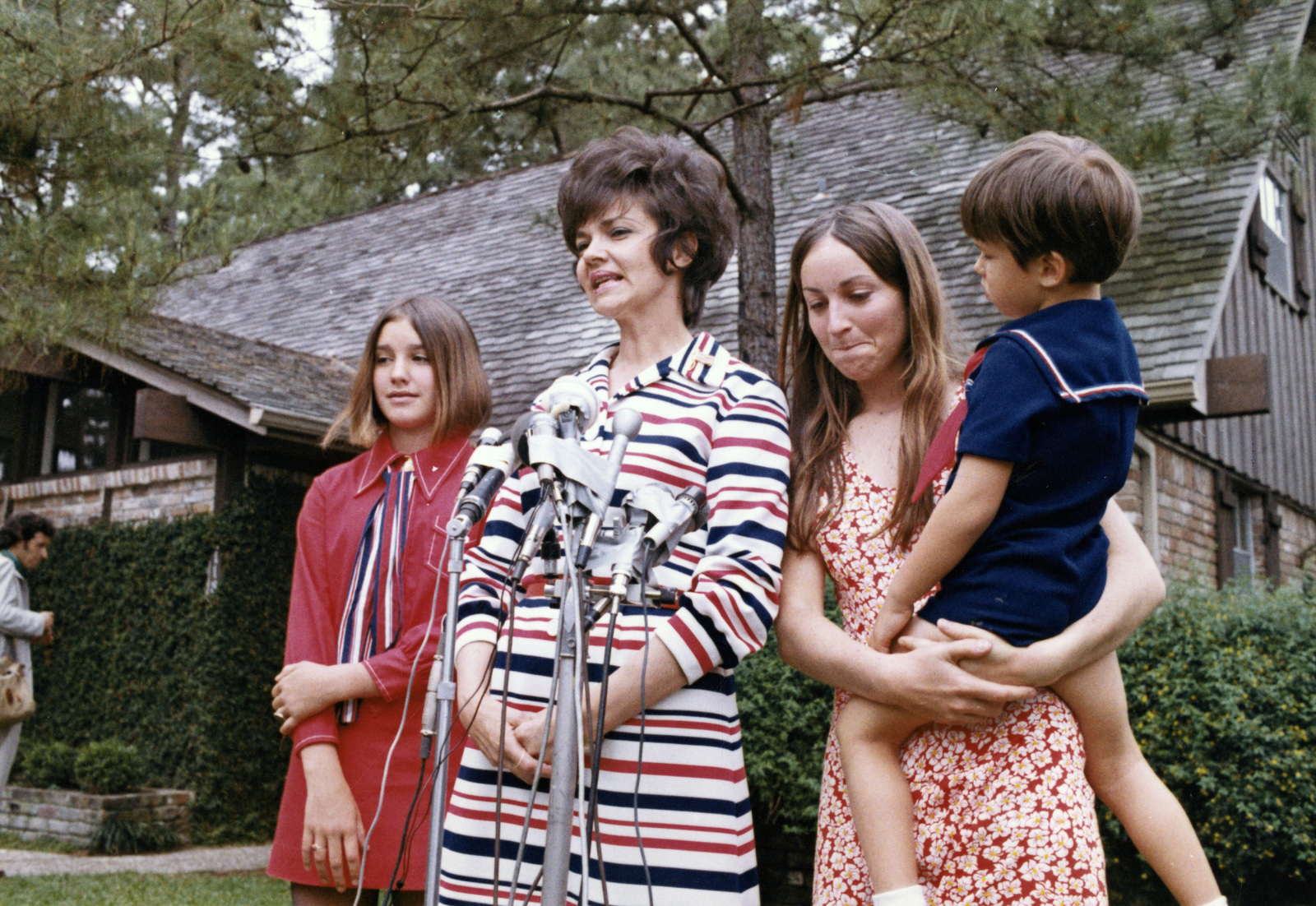 Photograph of Marilyn Lovell and 3 of Her Children Greeting
