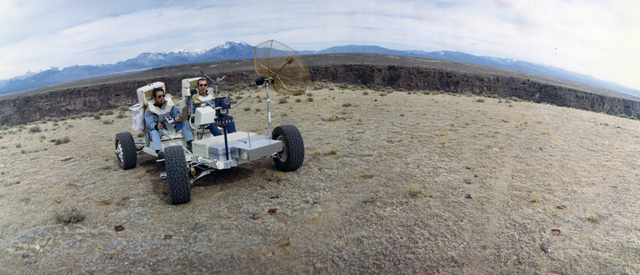 Photograph of Members of the Prime Crew of Apollo 15 Riding in a Lunar Roving Vehicle in Taos, New Mexico