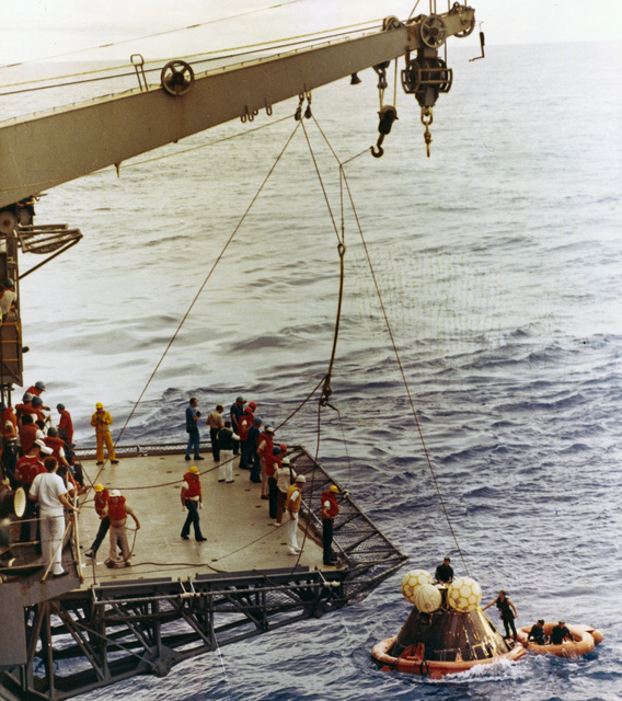 Photograph of the Apollo 13 Spacecraft Being Returned to the Prime Recovery Ship, USS Iwo Jima