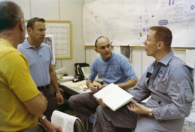 Photographs of Donald K. Slayton, James A. Lovell, Thomas K. Mattingly II, and John L. Swigert, Jr.  Reviewing Apollo 13 Mission Flight Plans