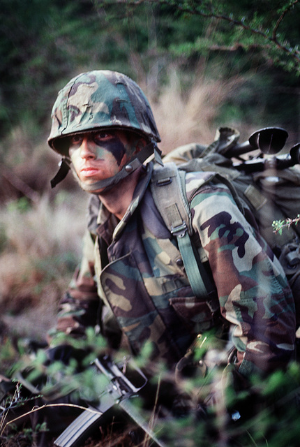 A marine armed with an M16A1 rifle participates in an assault during the joint service Exercise OCEAN VENTURE '84