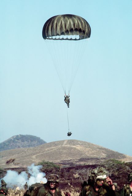 A member of the 82nd Airborne Division parachutes into Puerto Rican National Guard Camp Santiago during the joint service Exercise OCEAN VENTURE '84