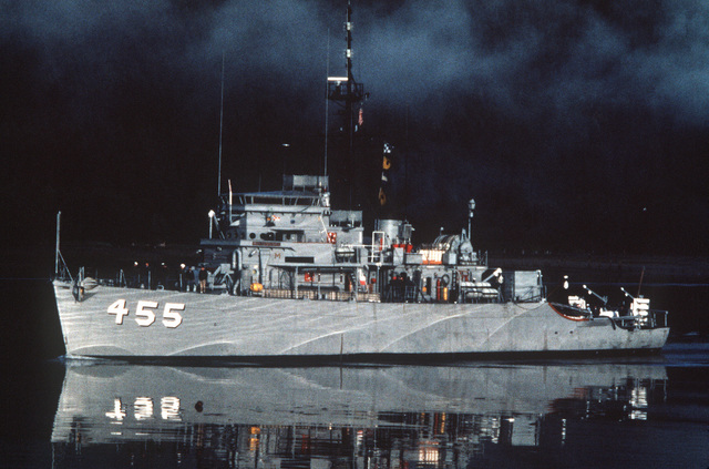 A port bow view of the ocean minesweeper USS IMPLICIT (MSO 455) underway near the coastline in the early morning. The ship is assigned to the Naval Reserve Force (NRF). (Exact date shot unknown)