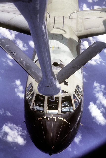 A view from a KC-135 Stratotanker aircraft boom operator's window of a B-52 Stratofortress aircraft as it approaches the refueling boom of the KC-135 during exercise Pitch Black '83-1