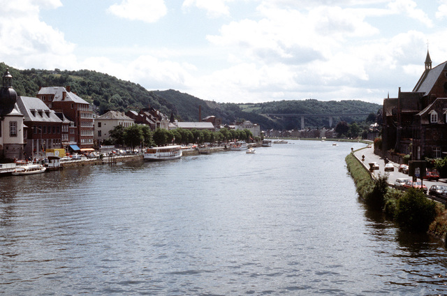 A view looking down the Rhine River, near Frankfurt, Germany, showing tourist boats, and hotels, restaurants and homes on either side. Exact Date Shot Unknown