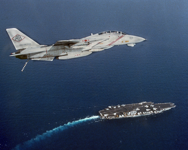 Air to air right side view of an F-14A Tomcat aircraft from Fighter Squadron 102 (VF-102) with its tailhook extended in preparation for landing aboard the aircraft carrier USS AMERICA (CV 66). The aircraft is armed with AIM-9 Sidewinder missiles and an AIM-54 Phoenix missile (on the fuselage). (SUBSTANDARD)