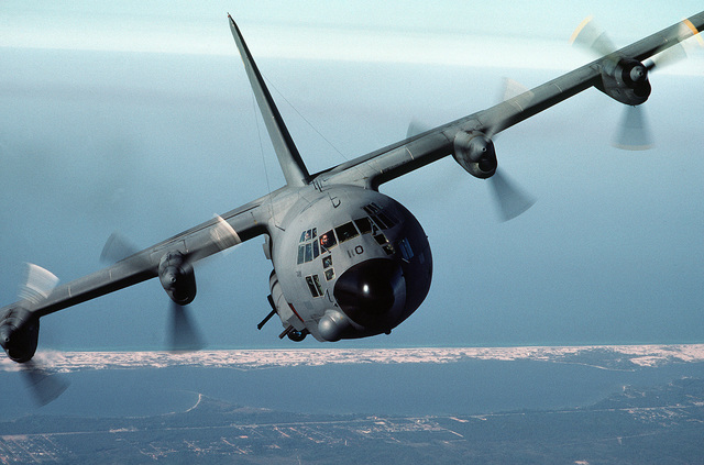 An air-to-air front view of an AC-130A Hercules gunship aircraft. The aircraft is from the 919th Special Operations Group (AFRESO), Eglin Air Force Base Auxiliary Field) 3 (Duke Field) Florida. AIRMAN Magazine, December 1984