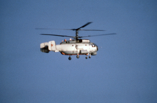 An air-to-air left side view of a Soviet Ka-27 Helix anti-submarine helicopter