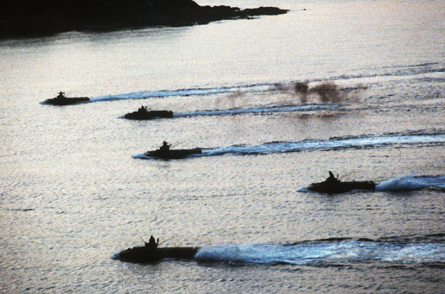 LVTP7 tracked landing vehicles, personnel, approach Vieques Island, Puerto Rico, during the joint service Exercise OCEAN VENTURE '84