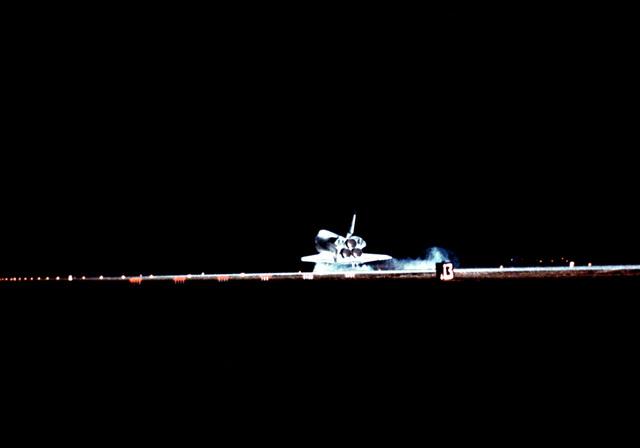 The space shuttle orbiter Challenger (STS-8) makes the first nighttime landing of the Space Transportation System as it touches down on Runway 22 at 12:40 am PDT at the end of a six-day mission. Aboard are Richard H. Truly, commander; Daniel Brandenstein, pilot; and mission specialists Guion S. Bluford, Dale A. Gardner and Dr. William E. Thornton