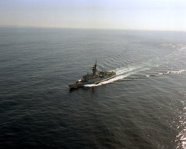 An aerial port bow view of the frigate USS HEPBURN (FF-1055) underway