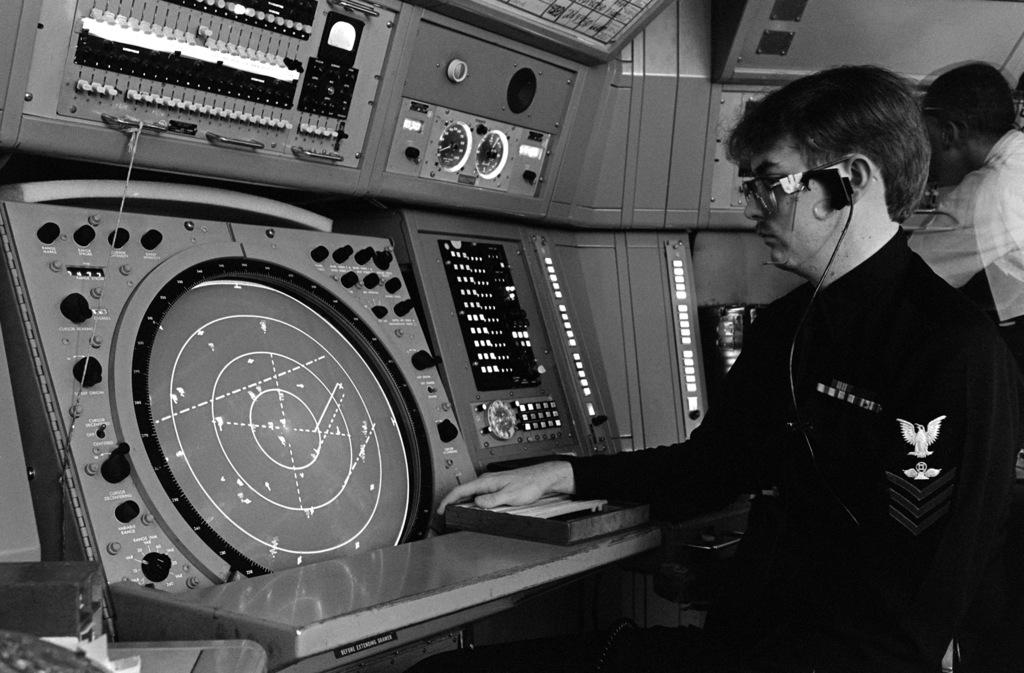 An air conrolman monitors a radar console in the radar room at Chambers Field