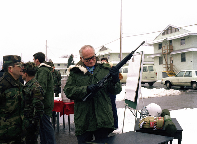 Retired US Senator Barry M. Goldwater examines an M16A1 rifle during his visit to the US Army Armor Center