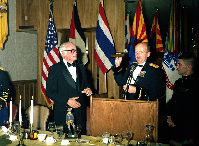 Retired US Senator Barry M. Goldwater, left, listens as Brigadier General Gordon R. Sullivan, Deputy Commander, US Army Armor Center, makes an after-dinner presentation during Goldwater's visit to Fort Knox