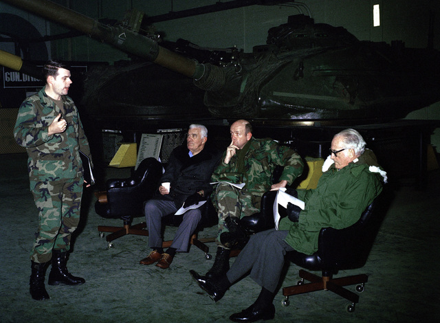Retired US Senator Barry M. Goldwater, right, and Brigadier General Gordon R. Sullivan, second from right, Deputy Commander, US Army Armor Center, listen to a presentation during Goldwater's visit to Fort Knox
