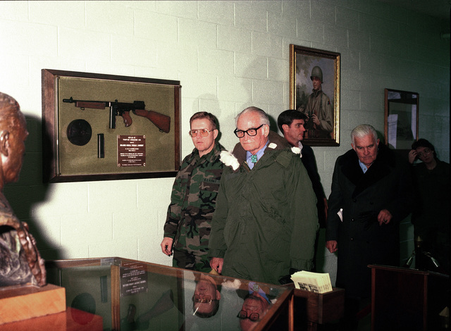 Retired US Senator Barry M. Goldwater, second from left, views an exhibit during his visit to the US Army Armor Center