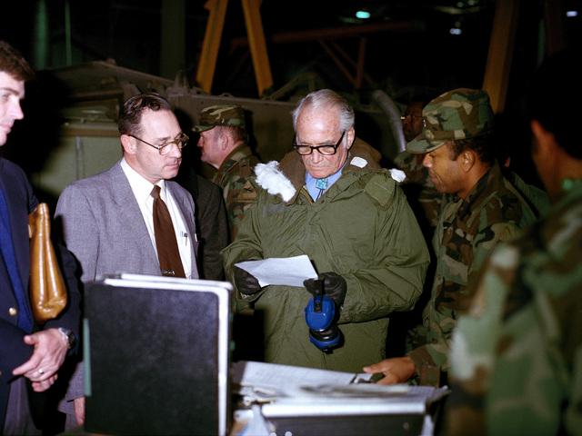 Retired US Senator Barry M. Goldwater, second from right, stops at a display during his tour of the US Army Armor Center
