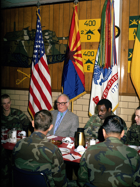 Retired US Senator Barry M. Goldwater shares a meal with a group of enlisted men during his visit to the US Army Armor Center
