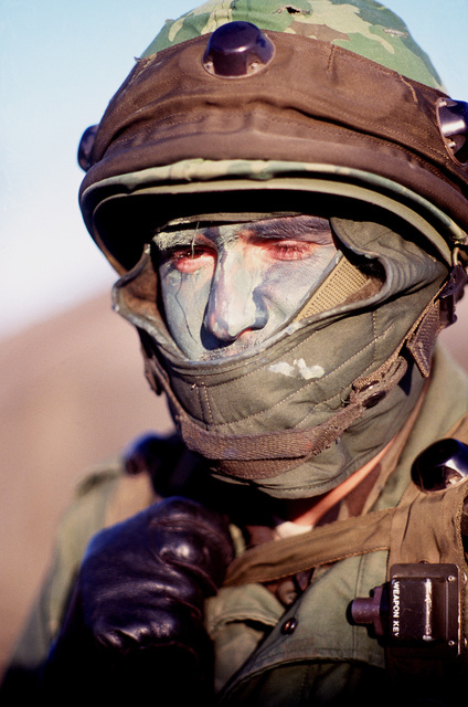 SENIOR AIRMAN (SRA) Donald Friday wears camouflage paint on his face during Exercise VOLANT SCORPION