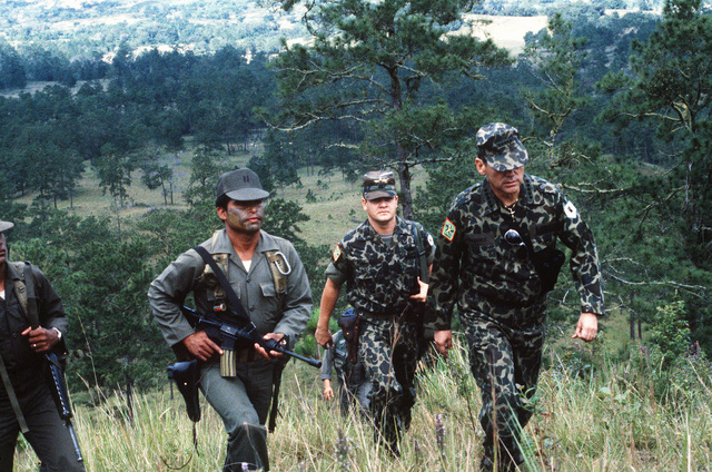 General Gustavo Adolfo Alvarez Martinez, chief of the Honduran armed forces, arrives at San Estaban Valley with his aides and bodyguards. Martinez is in the area to observe a parachute drop by Honduran troops during Exercise AHUAS TARA (BIG PINE) II