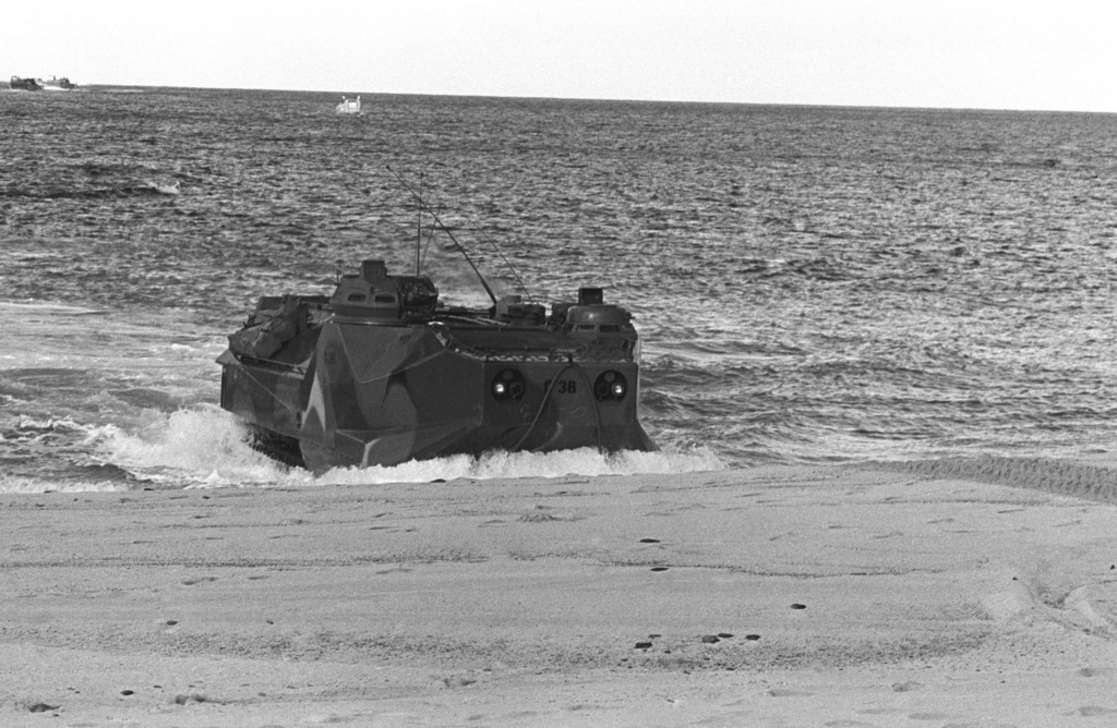 Marines come ashore on Makua Valley Beach in a tracked landing vehicle, personnel (LVTP 7) during Operation KERNAL BLITZ. The LVTP 7 is assigned to the 3rd Amphibious Assault Battalion, 1ST Marine Brigade