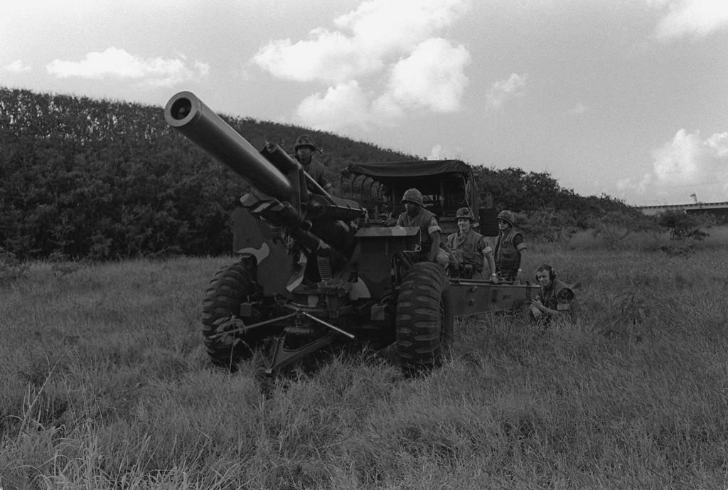 Marines from Kilo Battery, 1ST Battalion, 12th Marines, prepare to provide supporting arms fire with an M-114 155mm howitzer during Operation Kernel Blitz