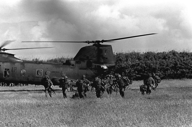 Marines from the 3rd Battalion, 3rd Marines, offload from a Marine Helicopter Squadron 165 (HMM-165), 1ST Marine Brigade, CH-46 Sea Knight helicopter during Operation Kernel Blitz