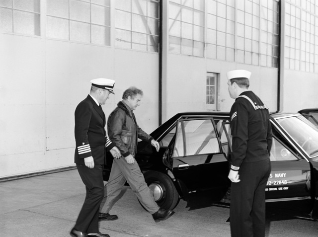 Captain J. A. McKenzie, CHIEF of STAFF, and Melvin R. Paisley, Assistant Secretary of Defense for Research and Engineering, leave Attack Squadron 128 (VA-128) for lunch