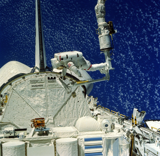 Astronaut Bruce McCandless II conducts an extravehicular activity (EVA) during Flight 41-B of the space shuttle Challenger. McCandless's boots are attached to a mobile foot restraint (MRF), which is attached to the end of the remote manipulator system (RMS) arm. The RMS is a cherry picker device used for manuvering outside the spacecraft