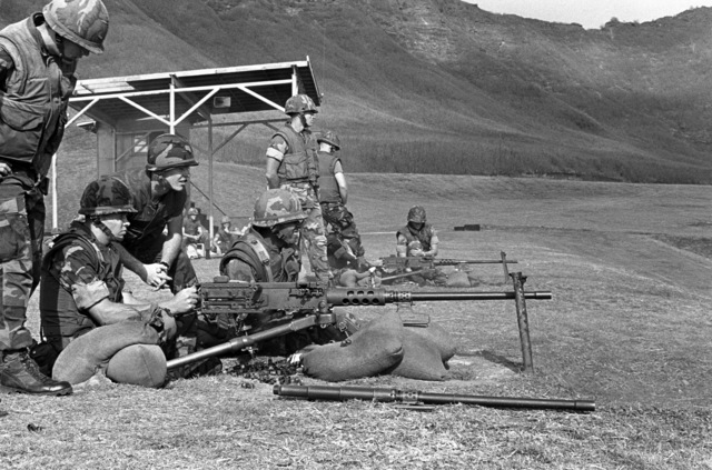 Students at the Small Unit Leadership Corse prepare to fire M-2 .50-caliber macine guns during their training