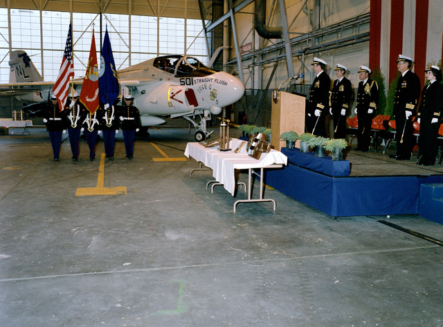 The colors are paraded during a Change of Command Ceremony in Hangar Six. Commander (CDR) Donald L. Sullivan is relieving CDR Donald L. Sullivan is relieving CDR Bruce V. Wood as Commanding Officer of Attack Squadron 52 (VA 52)