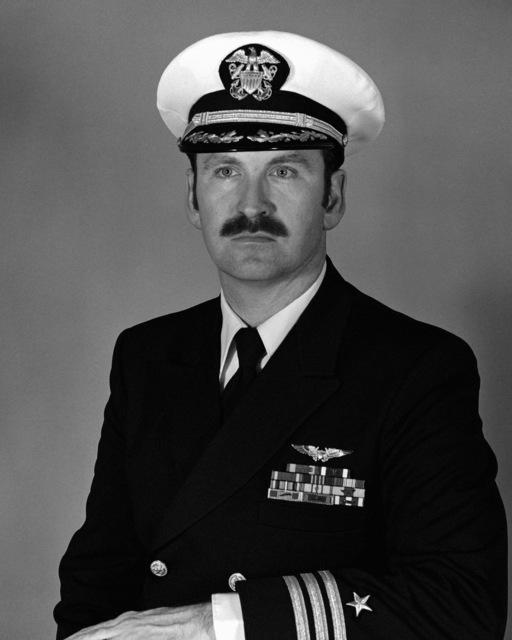 Commander Daniel A. Sigler, USN (covered)